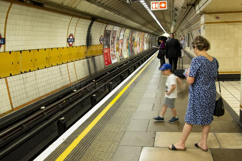 London, United Kingdom. August 22, 2009 - An interior view of the Underground Tube System in London, England, people waiting for stock images