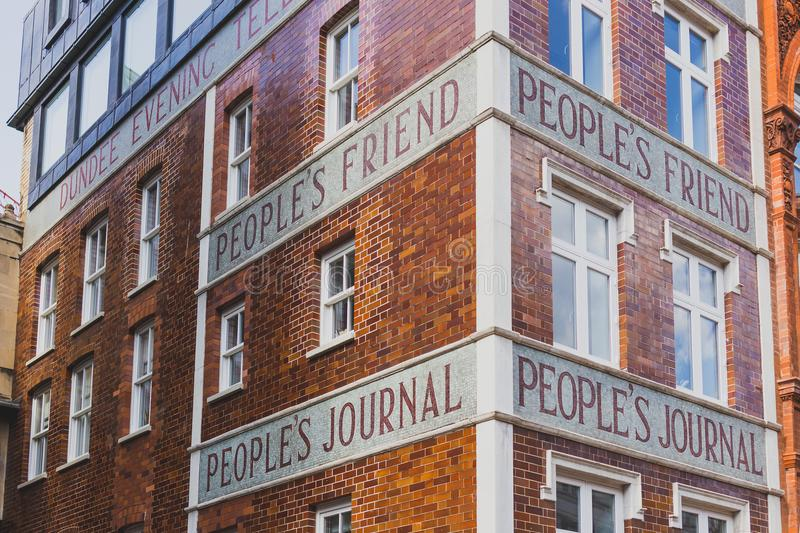 Exterior of the the Dundee Courier building. LONDON, UNITED KINGDOM - August 3rd, 2014: exterior of the the Dundee Courier building with text People`s Friend royalty free stock images
