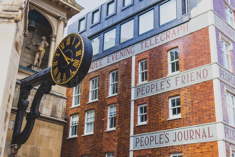 Exterior of the the Dundee Courier building. LONDON, UNITED KINGDOM - August 3rd, 2014: exterior of the the Dundee Courier building with text People`s Friend royalty free stock image