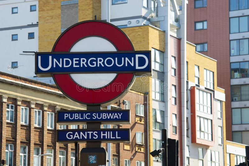 London, United Kingdom. August 22, 2009 - Typical London underground sign, street view background, United Kingdom. Copy space stock photos