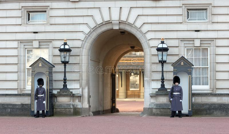 Guards in greatcoats on sentry duty at Buckingham Palace in London on February 21,. London, United Kingdom - Februari 21, 2019 : Guards in greatcoats on sentry stock images