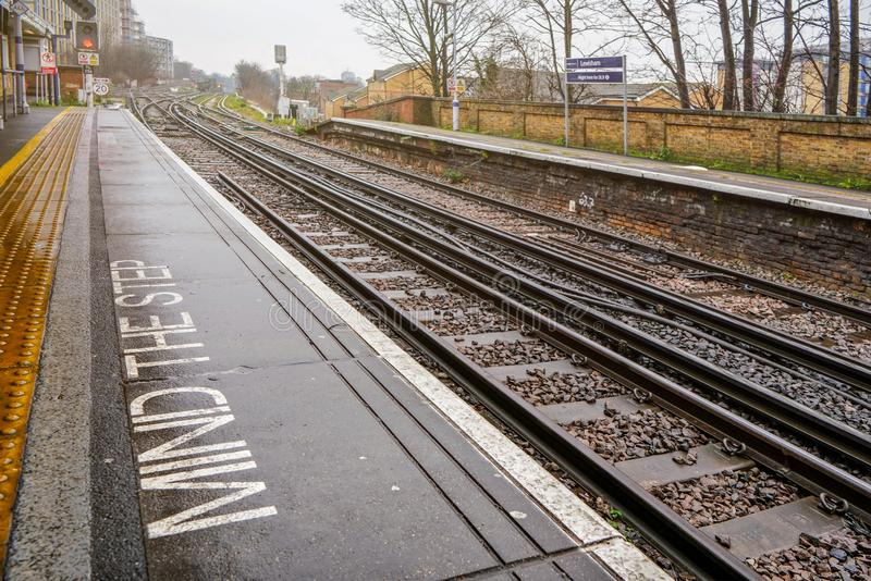 London, United Kingdom - February 01, 2019: Empty Rail tracks at Lewisham station on rainy day. Trains are used widely for public stock image