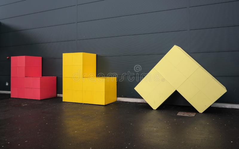 London, United Kingdom - February 05, 2019: Luton Airport sign Letters LLA made from colourful cubes in front of departure hall. Wall. LTN is 5th busiest in stock image