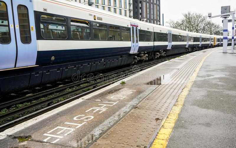 London, United Kingdom - February 01, 2019: National rail train at Lewisham station on overcast day, mind the step written on stock images