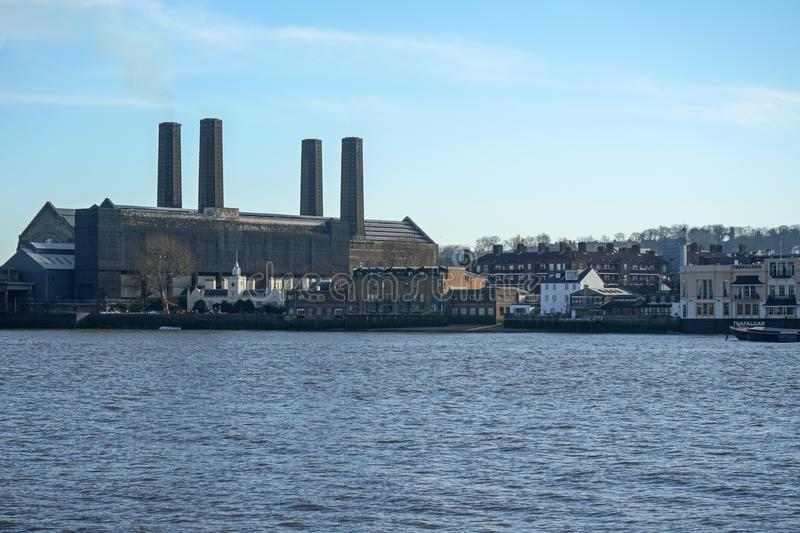 London, United Kingdom - February 03, 2019: South side of river Thames panorama in Greenwich borough, with Trinity Hospital. Building on left, photographed stock photo