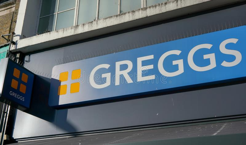London, United Kingdom - February 03, 2019: Sun shines on Greggs label over their Lewisham shop. They are largest bakery chain in royalty free stock photography
