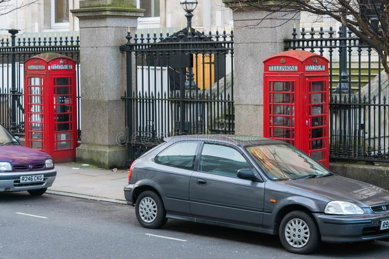 London, United Kingdom, February 17, 2018: Traditional London Red Telephone box stock photography