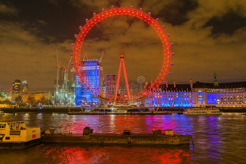 London, United Kingdom, February 17, 2018: UK skyline in the evening. Ilumination of the London Eye and the buildings royalty free stock photos