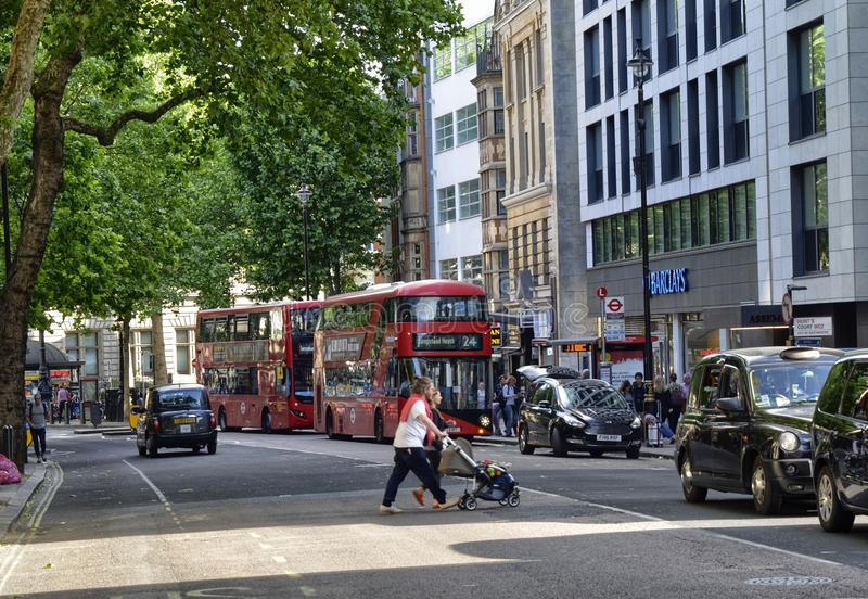 London, United Kingdom, June 2018. The appearance of the city around the Leicester square metro station. Double-decker buses, taxis called cabs, crowds of royalty free stock image