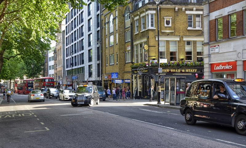 London, United Kingdom, June 2018. The appearance of the city around the Leicester square metro station. Double-decker buses, taxis called cabs, crowds of stock photo