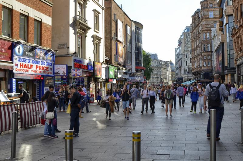 London, United Kingdom, June 2018. The appearance of the city around the Leicester square metro station. Taxis called cabs, crowds of tourists stock image