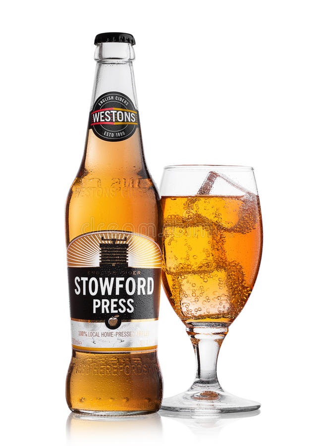 LONDON, UNITED KINGDOM - JUNE 22, 2017: Bottle and glass with ice cubes of Stowford Press westons cider on white. stock image