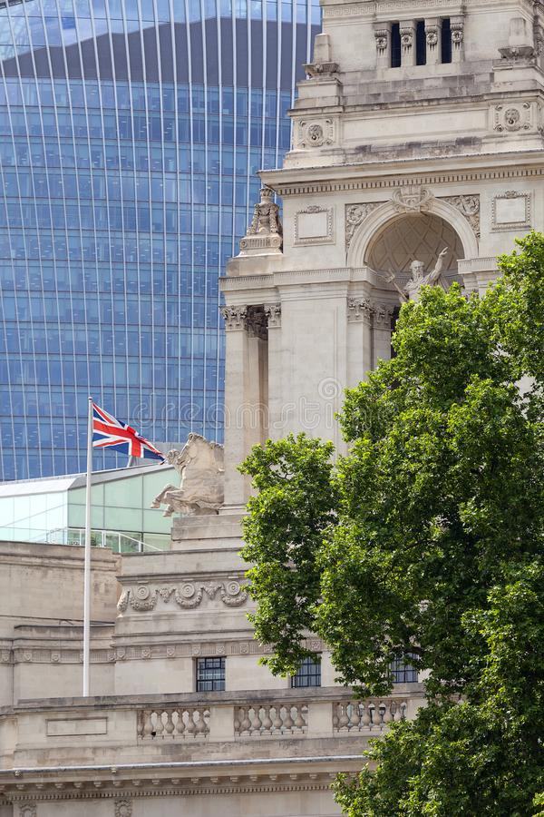 Building of 10 Trinity Square. In the background scyscraper 20 Fenchurch, London, United Kingdom. LONDON, UNITED KINGDOM - JUNE 22, 2017: Building of 10 Trinity stock photos