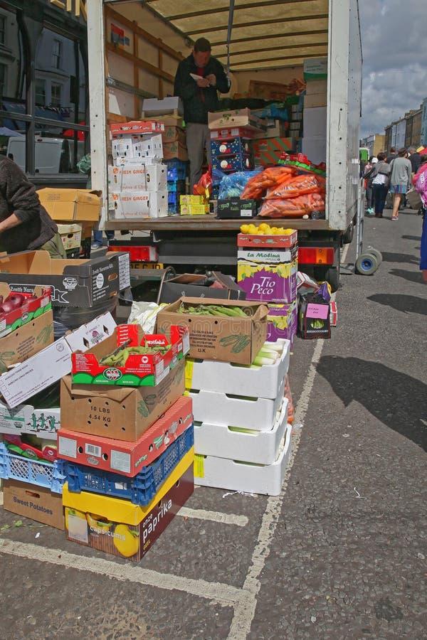 Portobello Road Market Delivery. London, United Kingdom - June 23, 2012: Fruits and Vegetables Truck Delivery to Portobello Road Market in London, UK royalty free stock images
