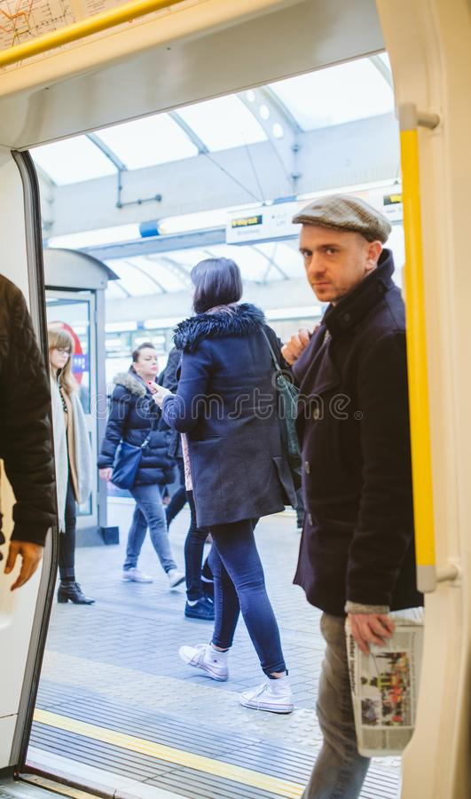 Man entrance in london tube wagon. London, United Kingdom - Mar 10 2017: Man entering London tube wagon in underground station royalty free stock images