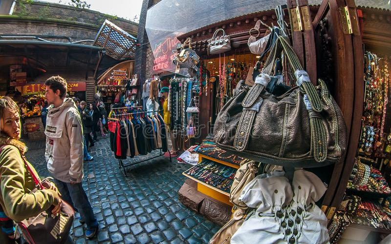 London, United Kingdom - March 31, 2007: Extreme wide angle fisheye photo of bags, clothes and other accessories on display at royalty free stock photos
