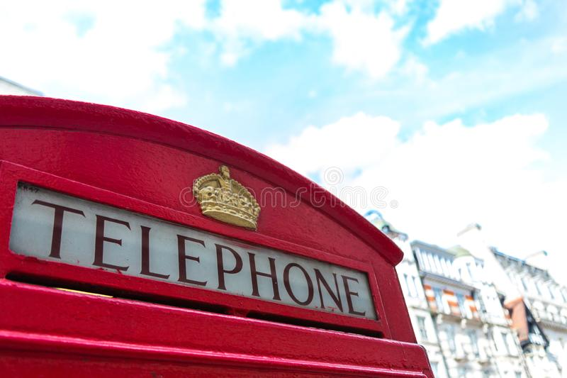 Telephone Booth. London, United Kingdom - March 27, 2015: One of the old, quickly disappearing red telephone boxes in central London stock photography