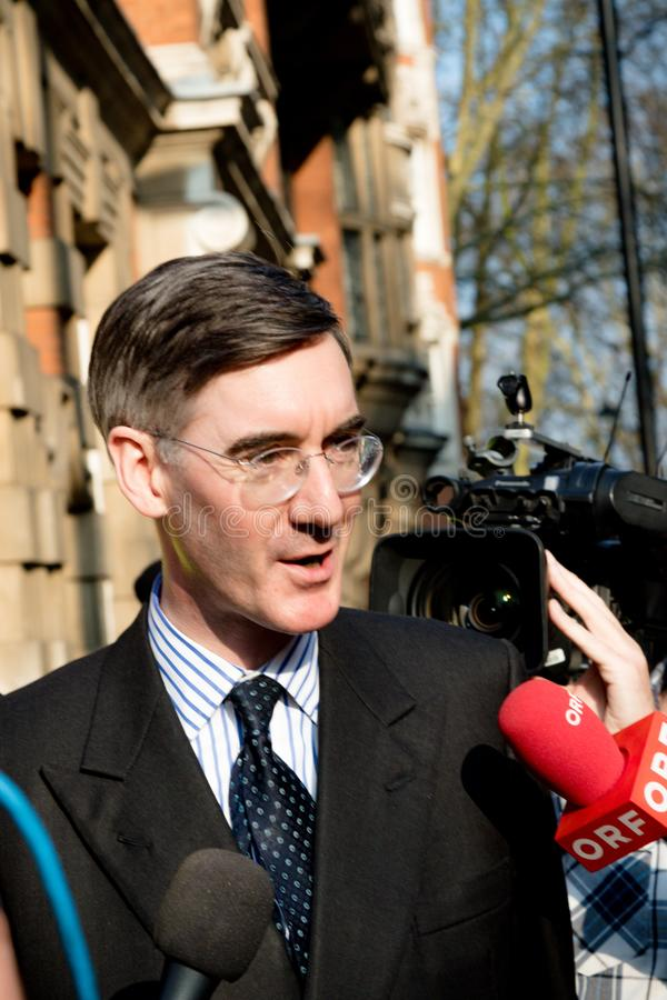 Brexit Day Protest in London. London, United Kingdom, March 29th 2019:- Conservative Member of Parliament Jacob Rees-Mogg leading supporter of Briexit leaves the stock images