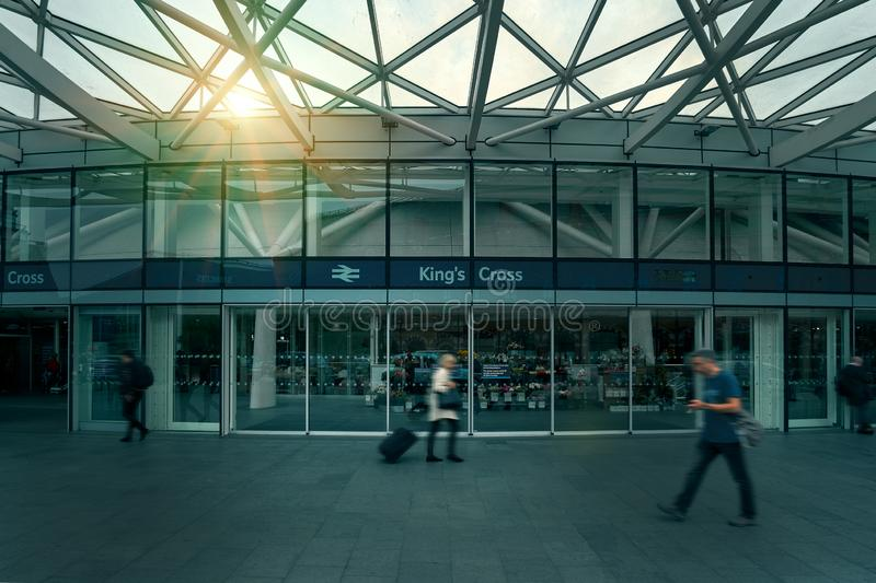 London, United Kingdom - May 24, 2018: Early morning at King`s Cross train station. People commuter walking. Blurred city workers royalty free stock image