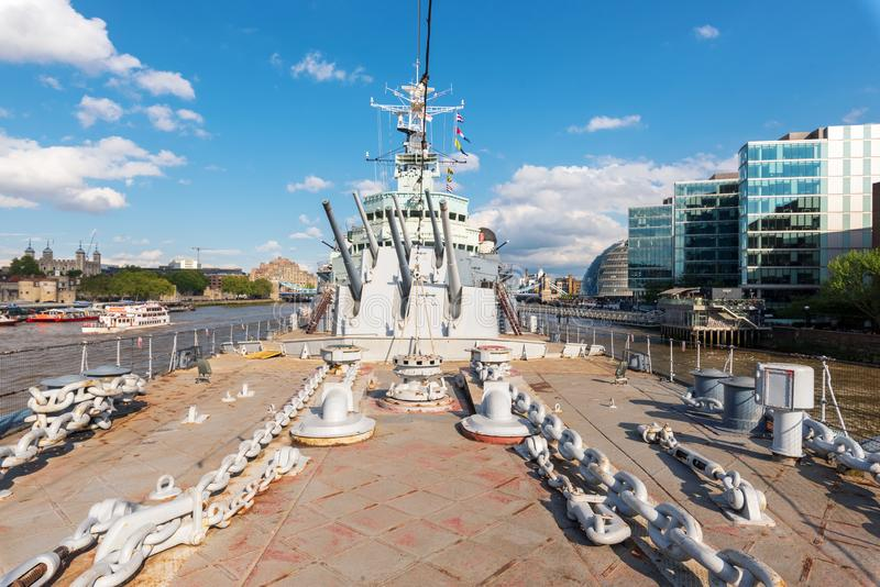 London, United Kingdom - May 13, 2019: View of HMS Belfast Royal Navy light cruise - warship Museum in London. Belfast. Moored in London on River Thames and stock photo