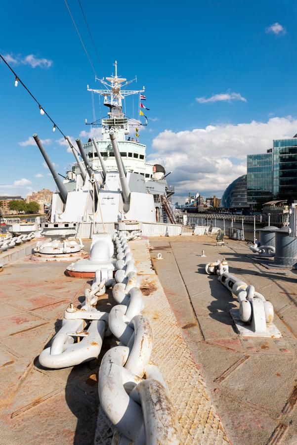 London, United Kingdom - May 13, 2019: View of HMS Belfast Royal Navy light cruise - warship Museum in London. Belfast. Moored in London on River Thames and stock image