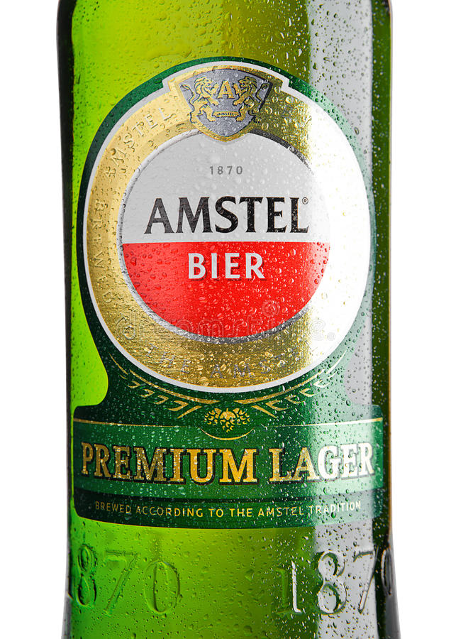 LONDON, UNITED KINGDOM - NOVEMBER 01, 2016: Cold bottle of Amstel Premium Lager on white background.Amstel is an internationally. Known brand of beer produced stock photos
