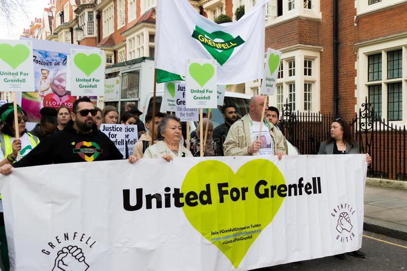 Silent March for Grenfell Tower in Kensington and Chelsea. London, United Kingdom, 14th April 2018:- Marchers on a silent march from Kensington Town Hall to the stock photography