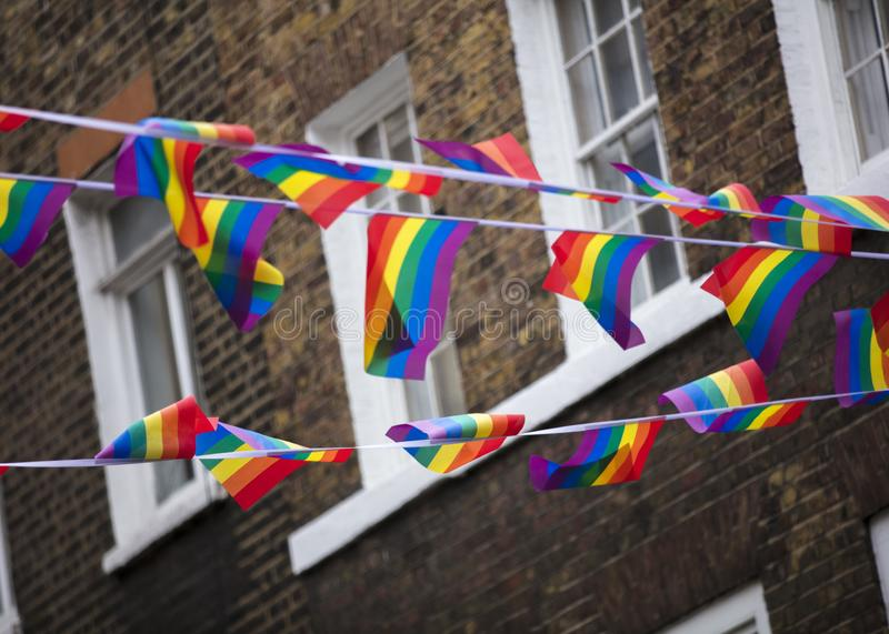 London, UK, 18th July 2019, Pride flags and bunting hung out in Soho in central london stock photos