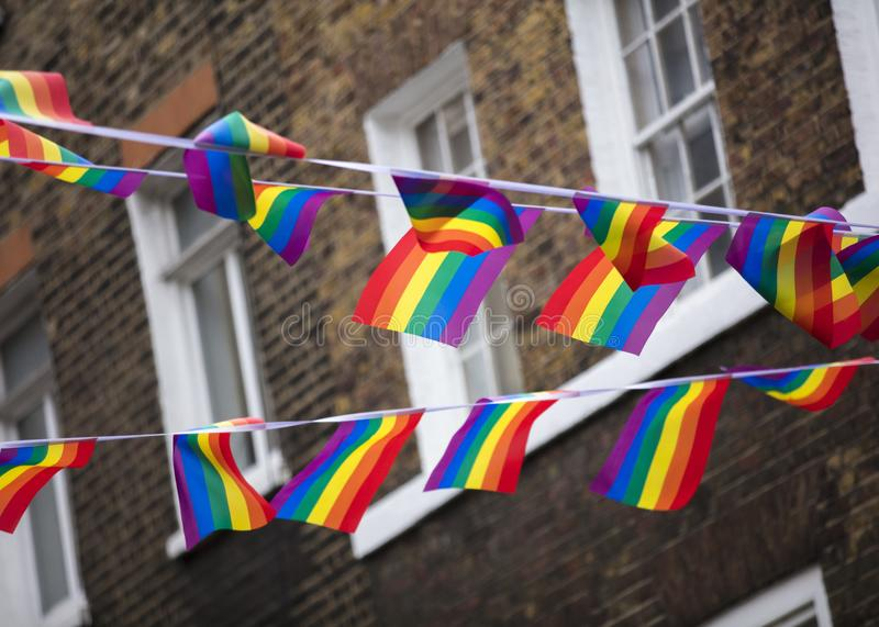 London, UK, 18th July 2019, Pride flags and bunting hung out in Soho in central london stock photography