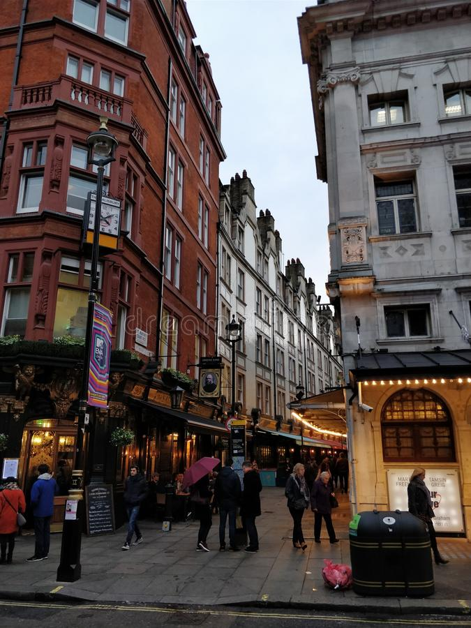 London, wet streets and cloudy day stock images