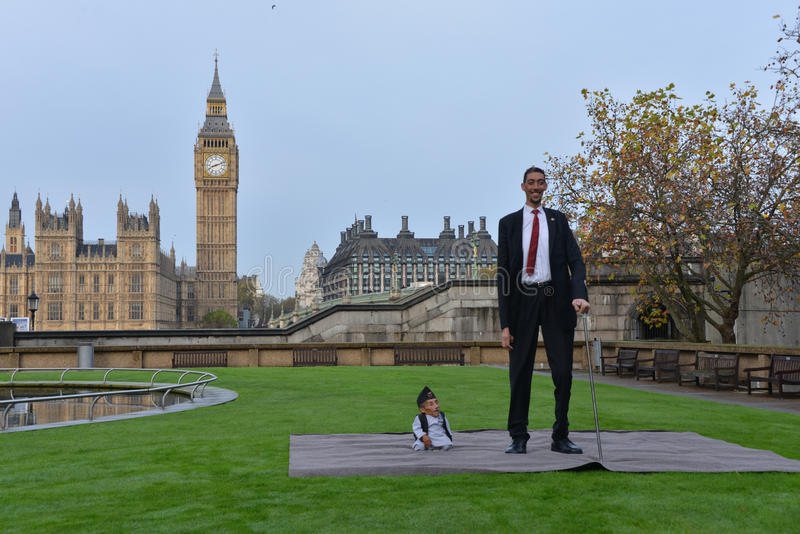 London: World's Tallest Man and Shortest Man meet on Guinness World Record royalty free stock photo