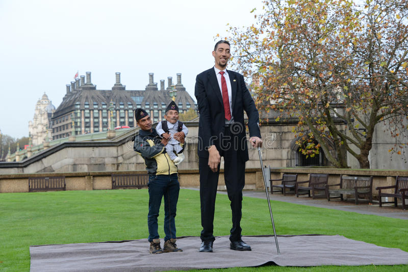 London: World's Tallest Man and Shortest Man meet on Guinness World Record. The world's tallest man and shortest man met for the first time on 13 November in royalty free stock images