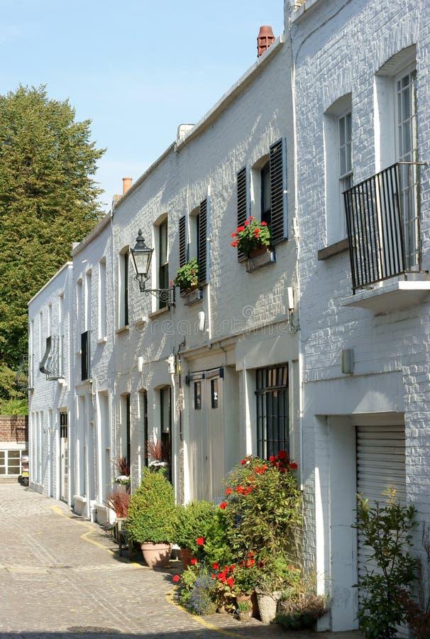 Londres maúlla las casas fotografía de archivo
