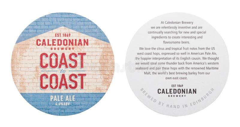 LONDRES, REINO UNIDO - 1º DE MARÇO DE 2018: Costa caledoniana da cervejaria para costear a pousa-copos original do beermat da cer ilustração do vetor