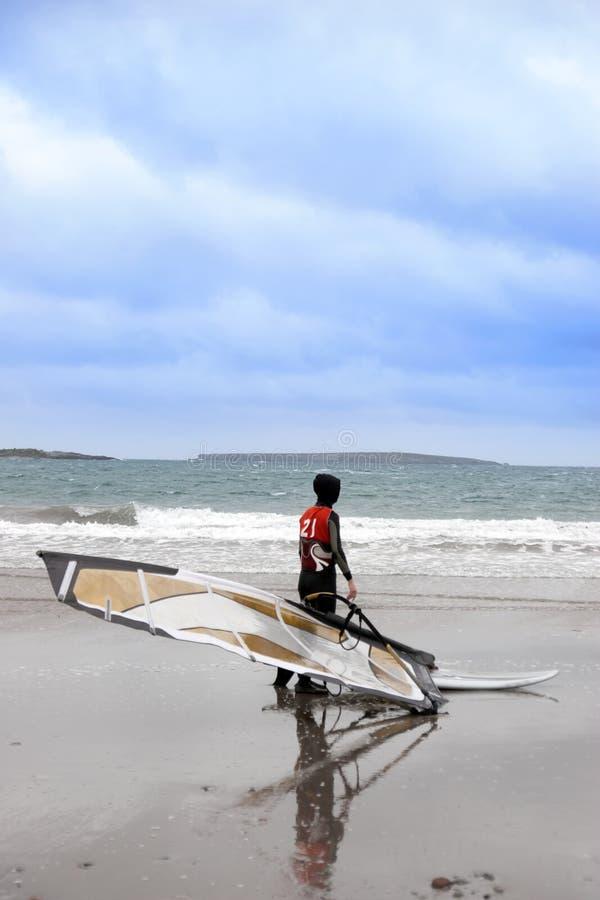 Lone Atlantic way windsurfer getting ready to surf royalty free stock photos