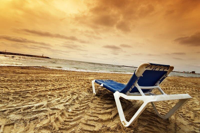 A lone beach chair stock photo