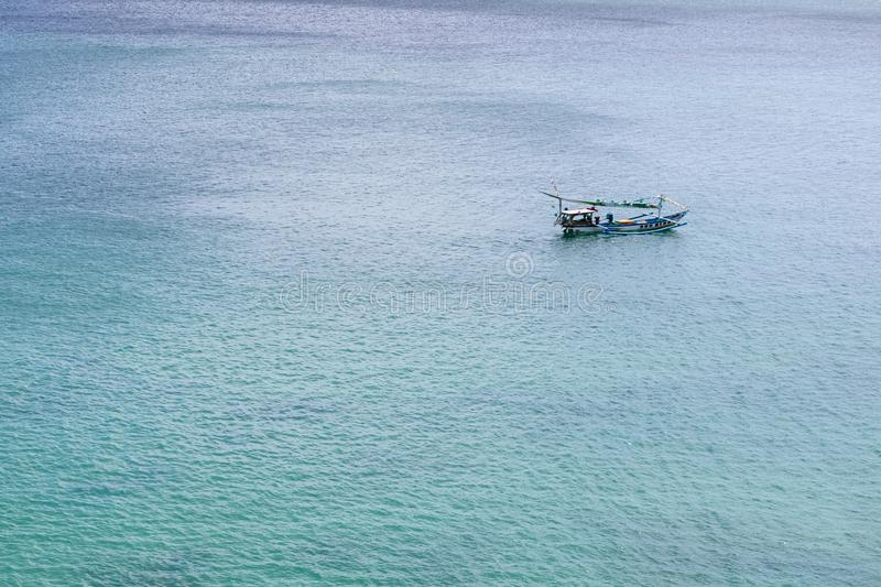 A lone boat floating on the ocean. By itself royalty free stock images