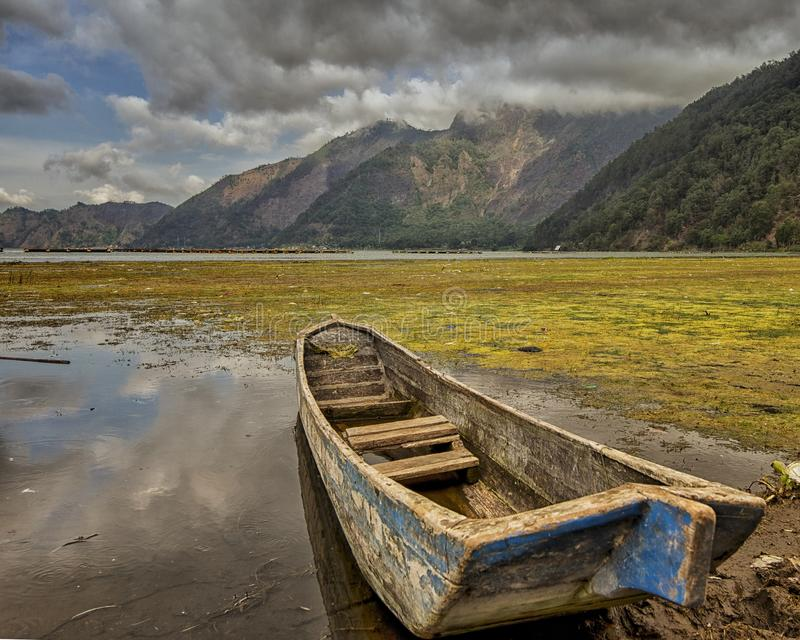 Lone Boat of Lake Batur. Lone Boat at the lakeside of Lake Batur, Bali, Indonesia royalty free stock photos