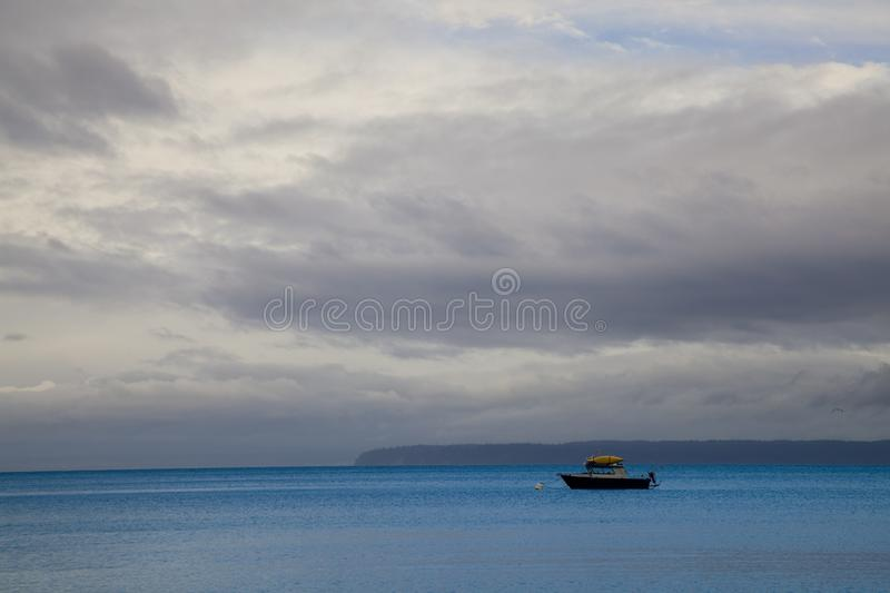 A lone boat on the ocean near Vancouver Island, British Columbia. Canada royalty free stock images