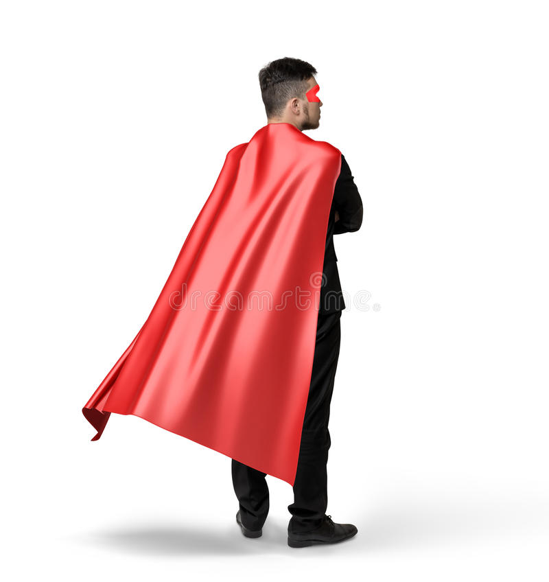 A lone businessman in red flowing cape in side 45 degrees view on white background. stock photos
