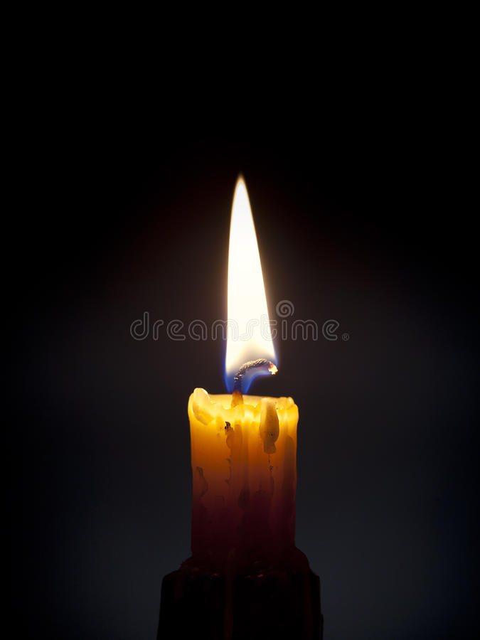 Lone candle burning royalty free stock photo