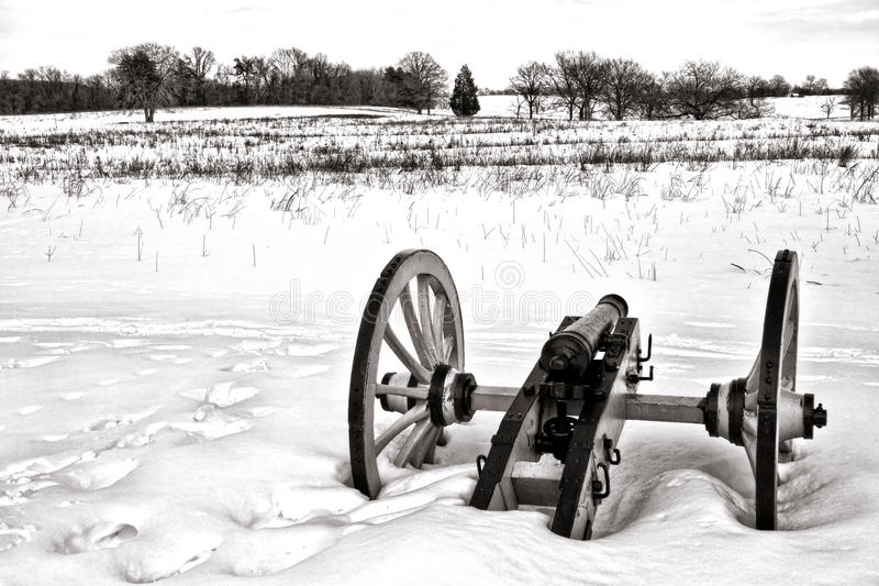 Lone Canon in Field at Valley Forge National Park. American Revolutionary War lone cannon in a snow covered field in winter at Valley Forge National Historical stock images