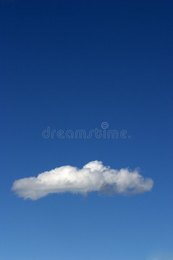 A lone cloud passes through Big Sky royalty free stock images