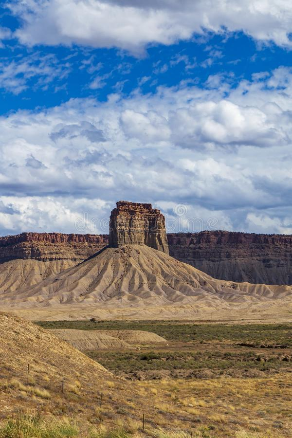 Lone Desert Butte In The  Southwest USA. Vertical image of a Lone Desert Butte In The  Southwest USA near four corners of AZ, UT, CO, & NM royalty free stock images
