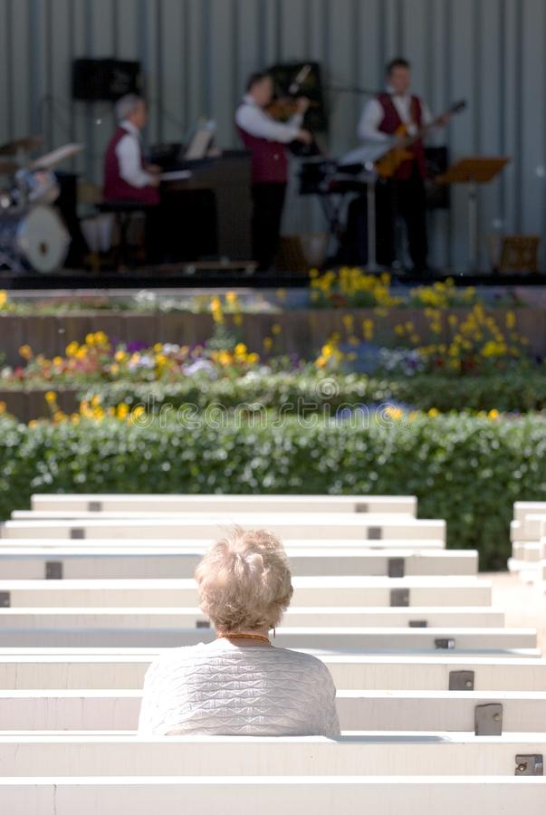 Lone elderly woman watching Jazz royalty free stock photos
