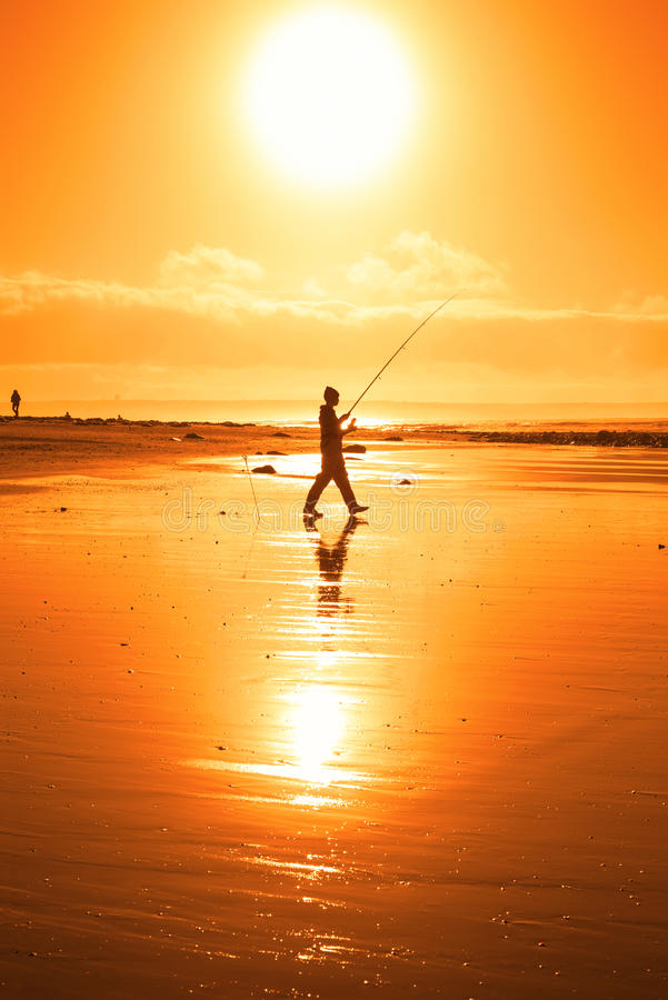 Lone fisherman fishing on the Kerry beach royalty free stock photography