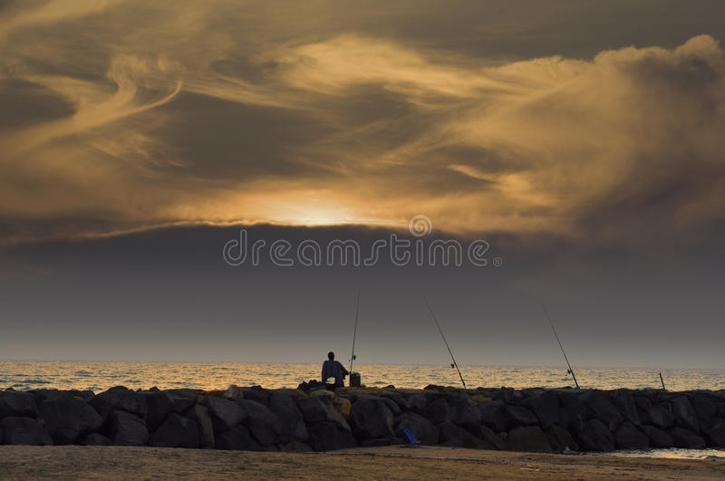 Download A Lone Fisherman At Sunset Stock Image - Image: 21375631
