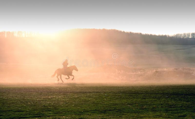 Lone Man on Horse Sunset Silhouette stock images