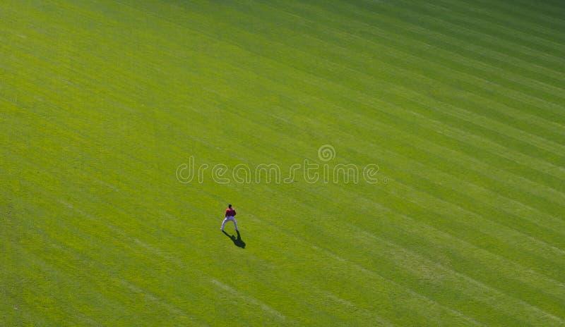 Download Lone outfielder fotografering för bildbyråer. Bild av ytterfält - 999201