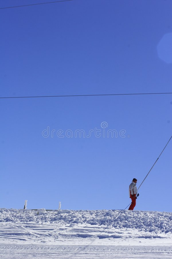 Lone skier on a drag lift stock images